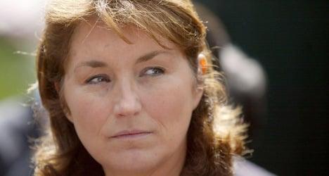Sarkozy's ex-wife talks of regret, scolding Gaddafi