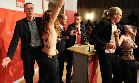 Mayor hit by topless protest over refugees