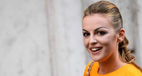 Berlusconi's fiancée sues over lesbian claims