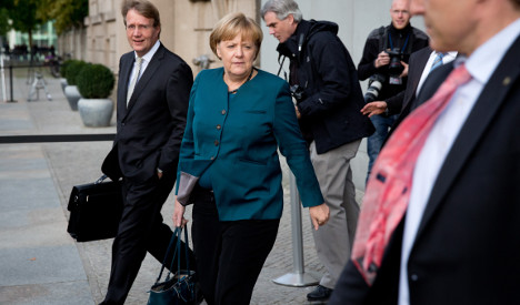Merkel and rivals upbeat after coalition talks