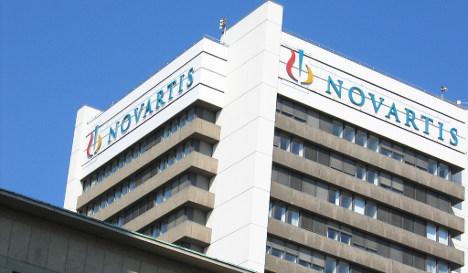 Novartis shares jump on improved outlook