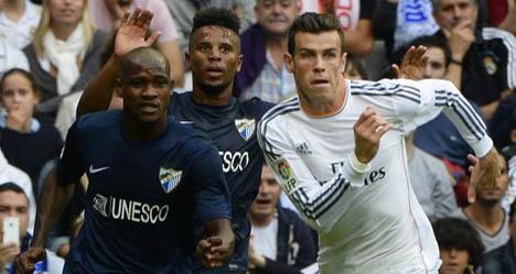 Real Madrid ease past Malaga as Bale returns