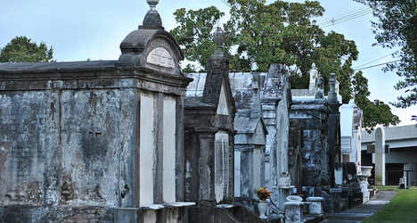 Woman dies after falling into husband's grave