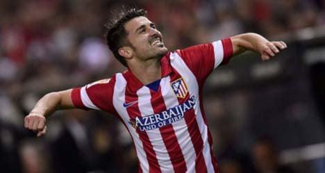 Villa double helps Atlético close in on Barça