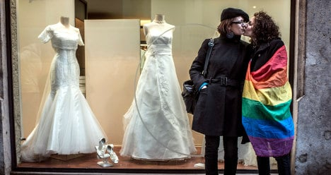 Italy's gay union ban allows Russian adoption