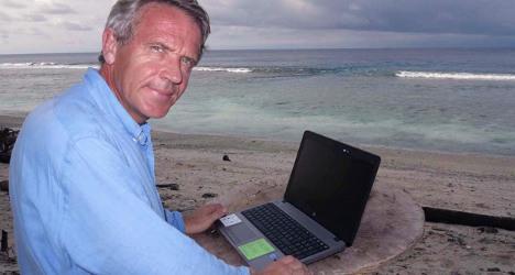 French boss runs firm from desert island beach