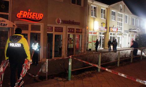 Manhunt begins after bank raid shoot-out