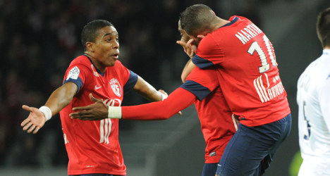 Lille win to stay in touch with PSG at top