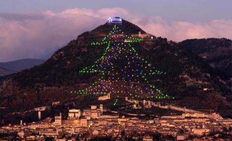 'World's biggest' Xmas tree lights up Italian town