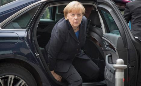 Merkel escapes limo crash unscathed