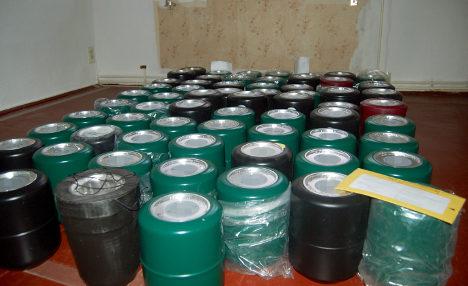 Funeral director hoards 67 urns in room