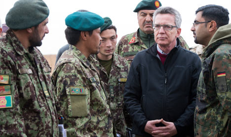 Germany tells Afghan leader to sign NATO pact