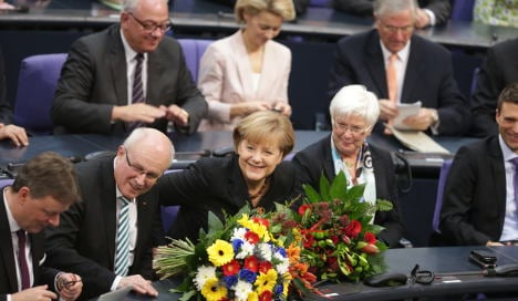 MPs elect Merkel to third term as chancellor