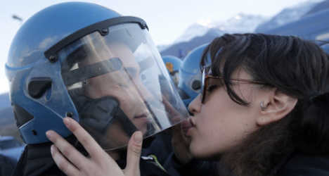 Italian protester's kiss was 'sexual violence'