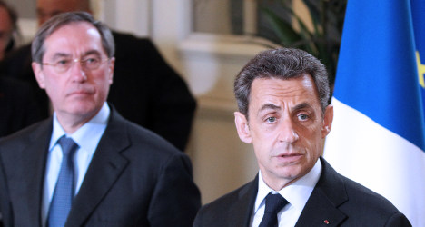 Sarkozy return hopes hit as cops grill two allies