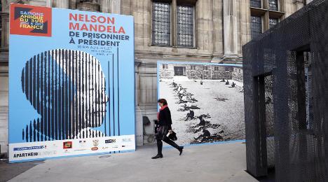France pays homage to 'conquerer' Mandela
