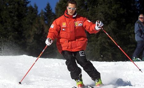 Schumacher 'blinks' as he is woken from coma