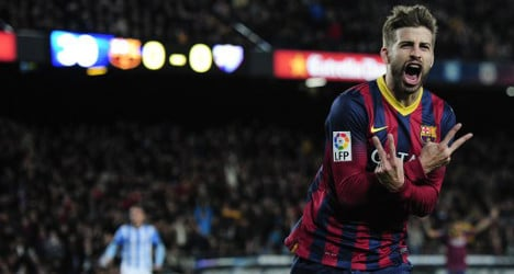 Barça get over boss blues with Malaga win