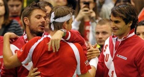 Swiss slay Serbia to advance in Davis Cup
