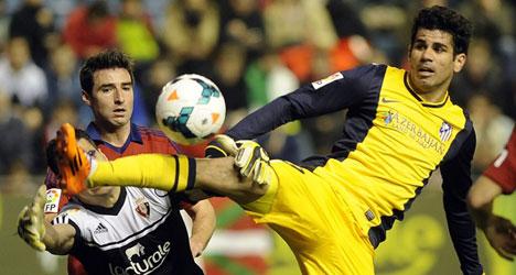 Osasuna thrashing dents Atletico title hopes