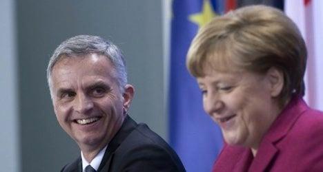 Germany's Merkel comes to Switzerland's defence