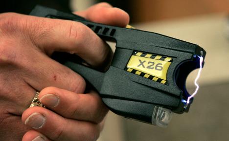 Widow charged for killing husband with stun gun