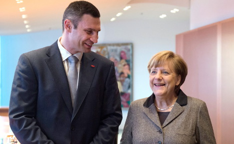 Merkel meets Klitschko, welcomes amnesty