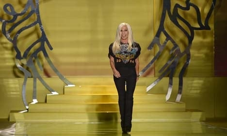 Versace agrees to sell minority stake to US firm