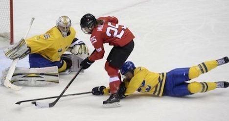 Schoolgirl leads Swiss to ice hockey bronze medal