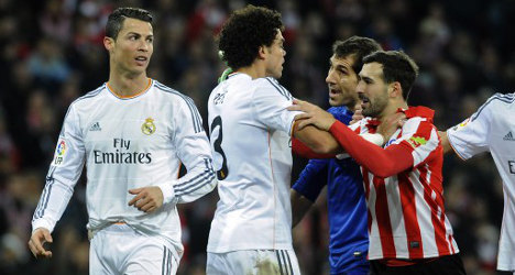 Atleti go top as Ronaldo's red holds Real back