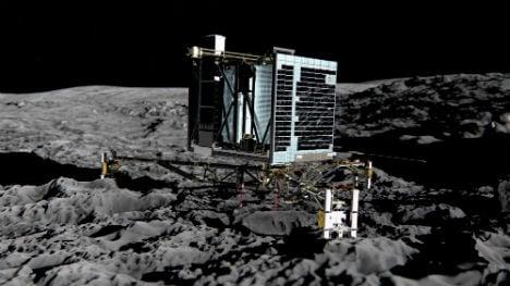 Comet lander awakes from long hibernation