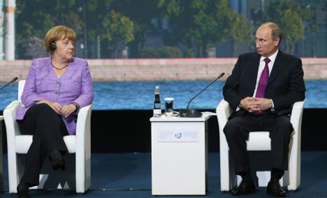 Merkel warns Russia of 'massive' damage