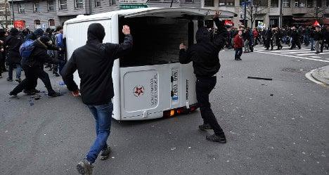 Masked protesters mar key economy summit