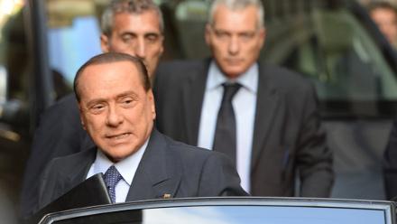 Berlusconi surrenders his 'knighthood'