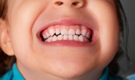 Bus driver forced 6-year-old girl to show her teeth