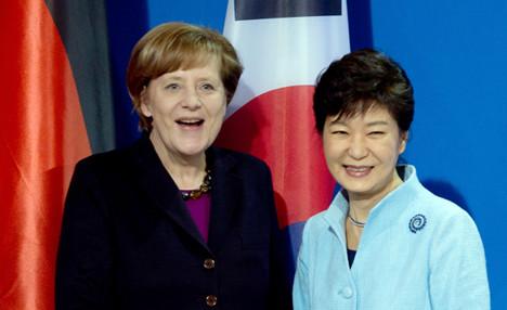 Merkel vows support for Korean reunification bid