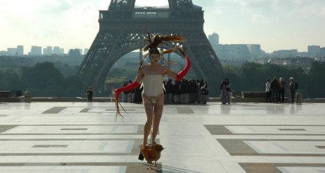 Artist defends Eiffel Tower coq dance in court
