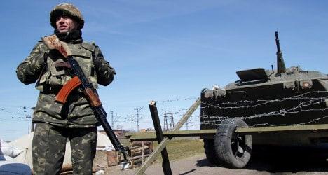 Crimea: France halts Russian military work