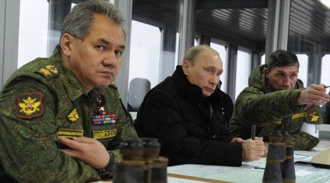France, UK urge Putin to stick to international laws