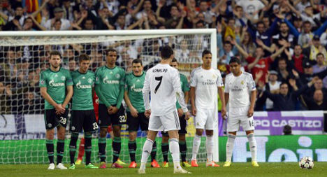 Ronaldo double seals Real's place in last eight