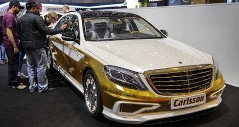 Gold-plated car shines at Geneva motor show