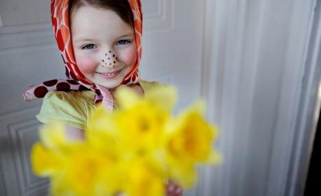 Kids in Victorian garb mark Swedish Easter