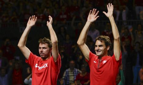 Federer sets up all Swiss tennis showdown