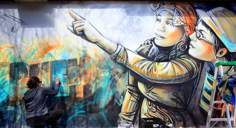 Rome street artist paints New York