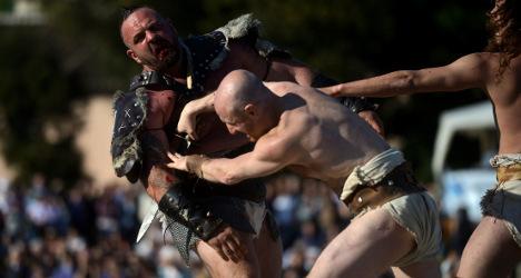 Gladiators and horsemen fete Rome's birthday