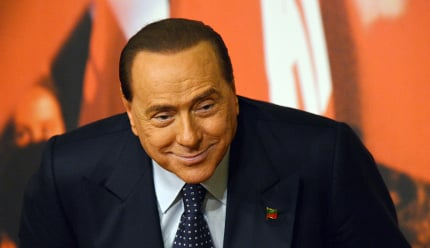 Berlusconi is 'pleased' to be helping the needy