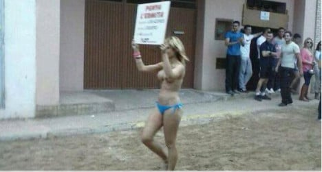 Topless woman touts for bull-running festival