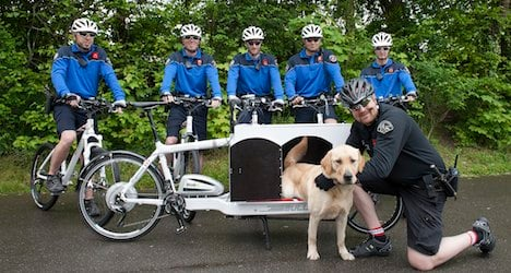 Lausanne cops pioneer bike for dog squad