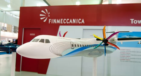 Italy's Finmeccanica switches to loss