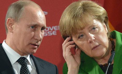 Merkel warns Russia of more Ukraine sanctions